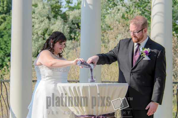 Bride and Groom Pouring Sand Into Candle Holder